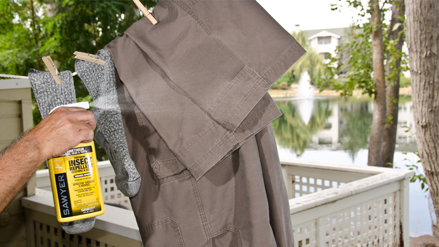 spraying permethrin clothing repellent